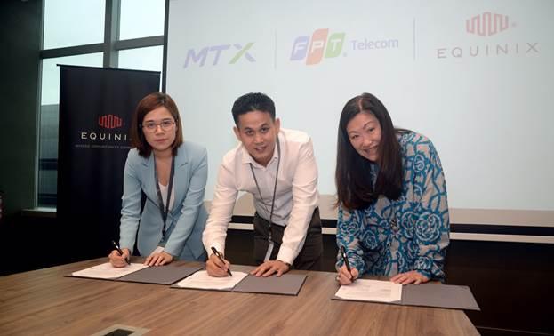 Đại diện MTX - FPT Telecom International - Equinix trong buổi lễ ký kết hợp tác.